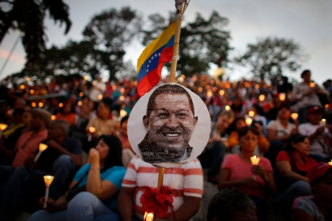 People hold candles during a praying ceremony for the health of Venezuelan President Hugo Chavez in Caracas Feb. 22, 2013.