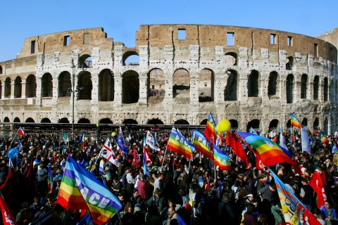 Anti-war protesters march in front of Rome's ancient Colosseum during a demonstration against war in Iraq.