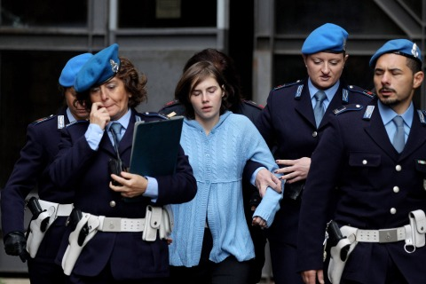 Amanda Knox is led away from Perugia's Court of Appeal by police officers after the first session of her appeal against her murder conviction on Nov. 24, 2010 in Perugia, Italy.