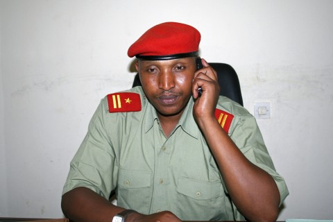 Fugitive Congolese warlord Ntaganda talks on his mobile phone at his office in Goma