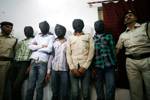 Five arrested in India over gang rape of Swiss tourist.