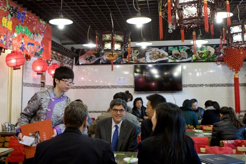 U.S. Treasury Secretary Jacob Lew, center, watches as embassy staff members order the foods during their lunch at a Chinese dumpling restaurant in Beijing