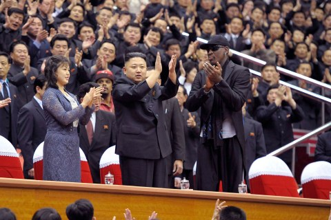 North Korean leader Kim Jong-Un, his wife Ri Sol-Ju and former NBA basketball player Dennis Rodman clap during an exhibition basketball game in Pyongyang.