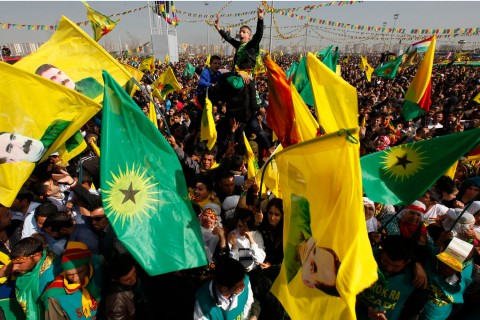 Demonstrators hold Kurdish flags and portraits of jailed Kurdistan Workers Party leader Abdullah Ocalan during a gathering to celebrate Newroz in the southeastern Turkish city of Diyarbakir on March 21, 2013.