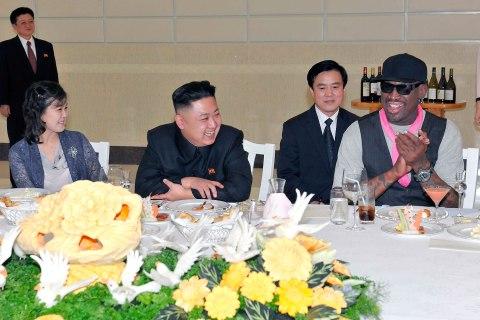 North Korean leader Kim Jong Un, his wife Ri Sol Ju, far left, and former NBA star Dennis Rodman dine in Pyongyang.