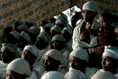 Jewish Ethiopian women attend a morning prayer service at a compound while awaiting immigration to Israel in Gondor