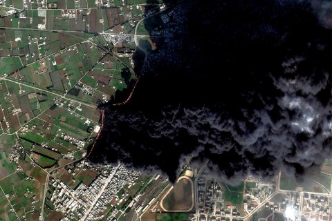 Smoke billows from a damaged oil and gas pipeline on the outskirts of the Baba Amr neighborhood in Homs, Syria on Feb. 15, 2012.