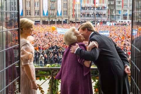 From Right: New Dutch King Willem-Alexander, his mother, Her Royal Highness Princess Beatrix, and his wife Queen Maxima appear on the balcony of the Royal Palace at the Dam Square in Amsterdam April, 30 2013.
