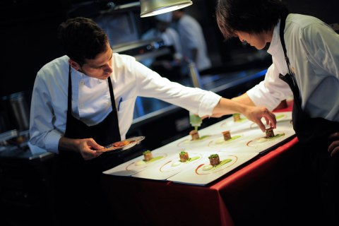 Cooks prepare dishes at the Spanish Restaurant El Celler de Can Roca on May 19, 2011 in Girona, Spain.