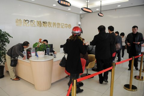 People line up to register for marriage or divorce in Shanghai, on March 6, 2013.