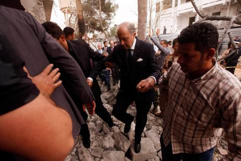 Laurent Fabius visits damaged houses around the French embassy in Tripoli