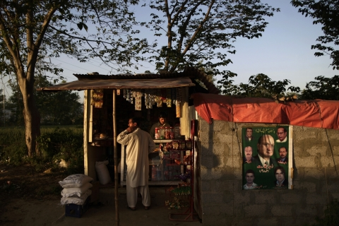 An election poster showing members of the political party Pakistan Muslim League  headed by opposition leader Nawaz Sharif, is seen right on a wall next to a grocery store in Islamabad.