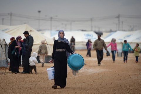 Syrian refugees go about their daily business in the Za'atari refugee camp in Za'atari, Jordan, Feb. 1, 2013.