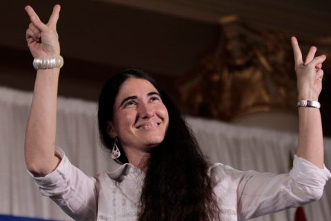 Yoani Sanchez, the best-known dissident blogger from Cuba, reacts to applause before speaking at the Freedom Tower in Miami