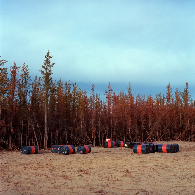 2011- Fuel drums lay on a clearing on an oil sands lease north of Fort McKay First Nation, Alberta.