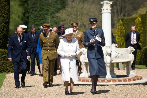 Queen Elizabeth II arrives to meet with patients and staff at the defense medical rehabilitation centre in Headley Court in Surrey, England, on May 02, 2013.