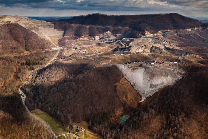 A Mountaintop Removal mine site and its accompanying valley fill hovers over a resident's home in Fayette County, WV. This site is operated by Frasure Creek Mining LLC which was sued in 2010 by four environmental groups for violations regarding their MTR in Kentucky. They were accused of committing over 20,000 water discharge violations and fraud for falsifying reports.