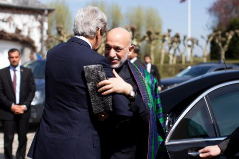 From Left: U.S. Secretary of State John Kerry greets Afghan President Hamid Karzai before a meeting with Pakistani Army Chief General Ashfaq Parvez Kayani (not pictured) in Brussels, on April 24, 2013.