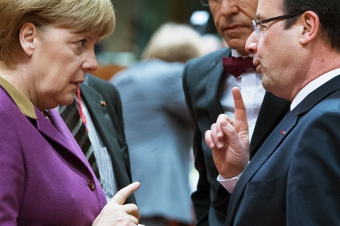 From left: German Chancellor Angela Merkel and French President  Francois Hollande during a roundtable meeting at the EU Headquarters in Brussels, on the second day of a European Union leaders summit, on March 15, 2013.