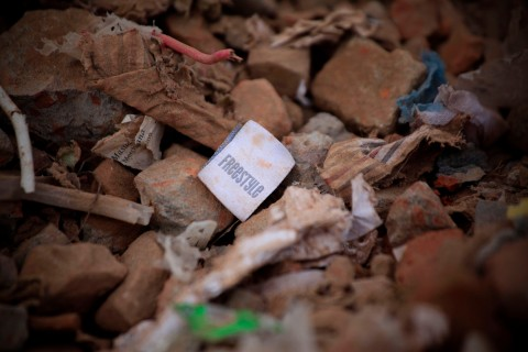 A clothes tag lies in the rubble of a garments factory that collapsed in Savar near Dhaka, Bangladesh, Saturday, May 5, 2013.