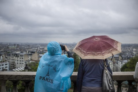 Tourists take pictures in the district of Montmartre in Paris, on May 20, 2013.