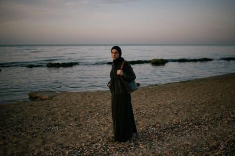 Zubeidat Tsarnaeva walks near the sea in Makhachkala on May 15, 2013.