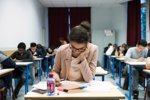 French students work take the baccalaureat exam (high school graduation exam) on June 17, 2013 at the Arago high school in Paris.