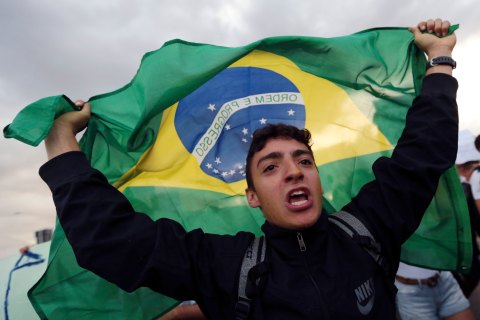 A demonstrator with the Brazilian flag protests against the Confederation's Cup and the government of Brazil's President Dilma Rousseff in Brasilia, on June 17, 2013.