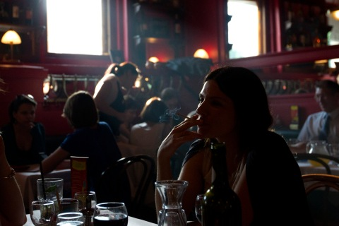 A woman smokes a cigarette in a cafe in Moscow, on May 31, 2013.
