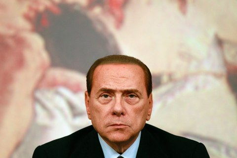 Then Italian Prime Minister Silvio Berlusconi looks on during a news conference at Chigi Palace in Rome August 4, 2011.