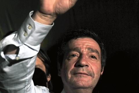 Newly elected mayor of Athens, George Kaminis waves to gathered crowds, on Nov. 14, 2010.