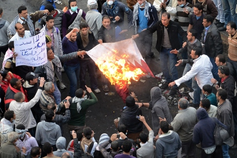 Egyptian protesters burn the Qatari flag in Tahrir Square in Cairo, on Jan. 27, 2013.
