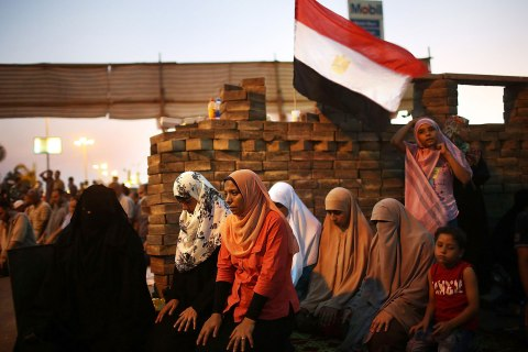 Female  supporters of ousted president Mohamed Morsi participate in the evening Friday prayer on the third day of Ramadan, the sacred holy month for Muslims where many will fast from sun-up to sun-down on July 12, 2013 in Cairo, Egypt.