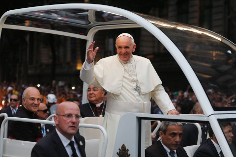 Pope Francis greets crowd of faithful from his popemobile in downtown Rio de Janeiro