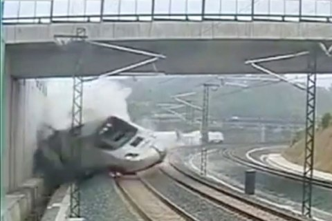 A train derails in this still image from the video of a security camera near Santiago de Compostela