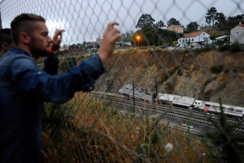 Onlookers view wreckage of train crash near Santiago de Compostela
