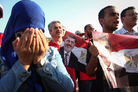 Following the call of Tunisia's Ennahda ruling party, dozens of supporters gathered outside the Egyptian Embassy in Tunis, Tunisia, in support of Egyptian President Mohamed Morsi on  July 7, 2013.