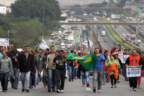 Protesters block stretch of highway in southeastern Brazil, on July 11, 2013.