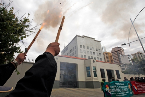 Demonstrator launch firecrackers outside the U.S. embassy to protest the denial of permission for Bolivia's President Evo Morales to enter the airspace of some European countries, in La Paz, Bolivia, on July 8, 2013.