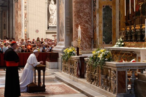 Pope Francis prays in front of the tomb of Pope John XXIII at the end of a mass on the 50th anniversary of his death, on June 3, 2013 in St. Peter's Basilica at the Vatican.