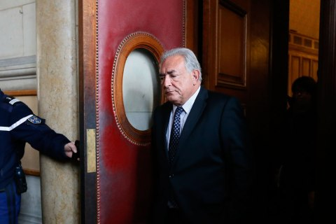 """Former IMF head Dominique Strauss-Kahn leaves the Paris courts after a hearing regarding his seizure request of the new book """"Belle et Bete"""" (Beauty and Beast) by author Marcela Iacub detailing their seven-month affair, on Feb. 26, 2013."""