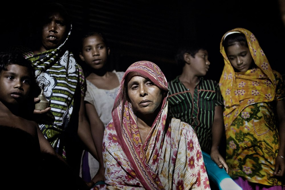Mother of dead worker Anis . Anis ( Anis relatives Khadiza thinks that Anis is look like that photo of two dead Person embracing , photo by Taslima. But his mother said this is not her son) worked at Phantom garment at Rana Plaza building. Rana Plaza, the 8- stored building where 5 garments factory were running, has collapsed on 24th April 2013 and 1131 workers dead so far  Jamalpur District. Bangladesh. 6th June 2013