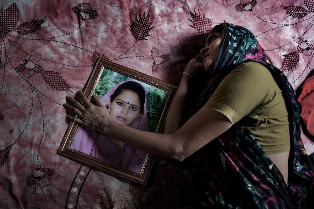 Mother of Poly Akther is weeping. Her daughter is died in the rubble. Rana Plaza, the 8- stored building where 5 garment factory was running, has collapsed on 24th April 2013 and 1131 workers dead so far.1st June 2013. Savar , Dhaka. Bangladesh