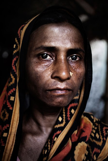 _ For our poverty I bound to send my loving sons to garment_ Anwara Begum, Mother of Shaheen Reza (21) and Al Amin(18) both are workers from Rana Plaza.One is missing another is dead. Anwara Begum, Mother of missing worker Shaheen Reza (21) and dead worker Al Amin(18) both are workers from Rana Plaza. One was working at 5th floor at finishing section another was at 6th floor at quality checking section. Both are brother. One is missing another is dead. Both of these two brothers are cousin of Jahidul who's wife is missing. Rana Plaza, the 8- stored building where 5 garments factory were running, has collapsed on 24th April 2013 and 1131 workers dead so far They live in a same village. Panch bibi, Joypur Hat, Bangladesh. 2nd June 2013