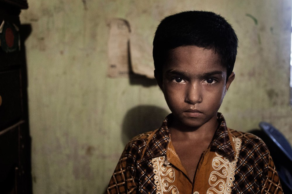 03.	Missing workers Rehana's son Mehedy Khan(8).  He reads in class II at Daffodil school. Still he waits for her mother. Rana Plaza, the 8- stored building where 5 garments factory were running, has collapsed on 24th April 2013 and 1131 workers dead so farSavar, Dhaka, Bangladesh. 5th June 2013