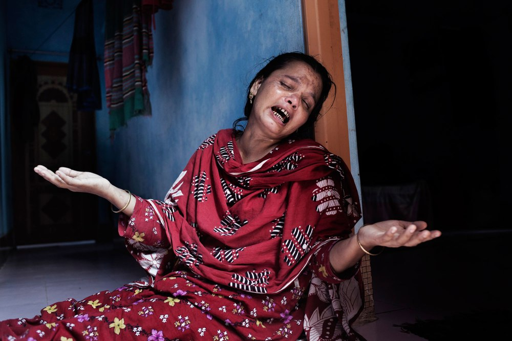Missing Workers Suroj's Mother is weeping. All the time she pass in a trauma and cries for her son . Rana Plaza has collapsed on 24th April 2013 and 1131 workers dead so far 1st June 2013. Savar , Dhaka. Bangladesh