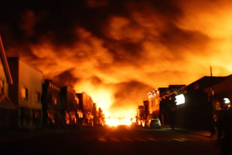 Fire from a train explosion is seen in Lac Megantic