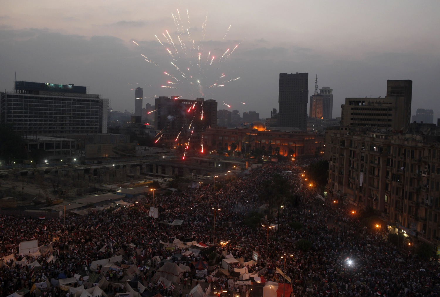 Fireworks go off as protesters, who are against Egyptian President Mohamed Mursi, gather in Tahrir Square in Cairo
