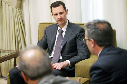 Syria's President Bashar Assad gives an interview with the al-Thawra newspaper in Damascus, July 3, 2013.