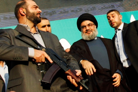 Center: Hezbollah leader Sayyed Hassan Nasrallah, escorted by his bodyguards, greets his supporters at an anti-U.S. protest in Beirut's southern suburbs, on Sep. 17, 2012